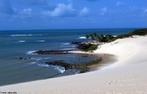 Praia de Genipabu localiza-se no município de Extremoz, a 25 quilômetros da capital potiguar e as dunas atraem turistas do mundo inteiro em busca do passeio de Buggy.  </br></br>  Palavras-chave: Praia. Passeio. Dunas. Turismo. Economia.