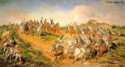 """Pedro Américo de Figueiredo e Melo (1843-1905). Pintor de origem humilde foi subvencionado pelo Império de D. Pedro II indo estudar em Paris, onde foi consagrado. Sua pintura de estilo acadêmico abrange temas bíblicos e históricos. Sua principal obra é """"Independência ou Morte"""". Pintado em 1888, por encomenda de D. Pedro II, este quadro, também conhecido como """"O grito do Ipiranga"""", pretendia representar o momento da independência do Brasil de forma a engrandecer e restaurar o poder da monarquia, já em declínio perante a proximidade da proclamação da república. O quadro tornou-se bastante popular no imaginário do povo brasileiro, mas está longe de ser um registro verdadeiro. Historiadores provam, por exemplo, que D. Pedro I montava uma mula e estava em trajes mais modestos, além de ter feito uma parada providencial às margens do riacho Ipiranga por conta de uma diarréia. </br></br>Palavras-chave: Brasil. Independência. Colonização. Império."""